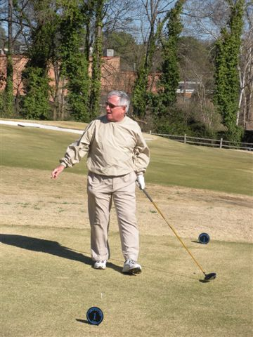 Marty Arnold prepares to take opening tee shot of 2013 season