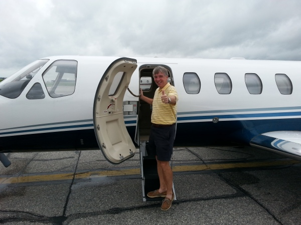 7-2-2013 Jim Williamson boards ATAG private jet for trip to Baltimore