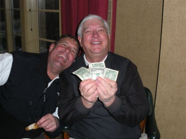 3-25-14 Low Net Winner Mike Gaddis shows the cash while teammate Lee Pearson hams it up