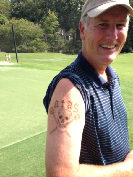8-12-14 Doug Healy proudly shows his new permanent ATAG tattoo